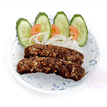 seekh-kebabs-in-with-cucumbers-and-tomatoes